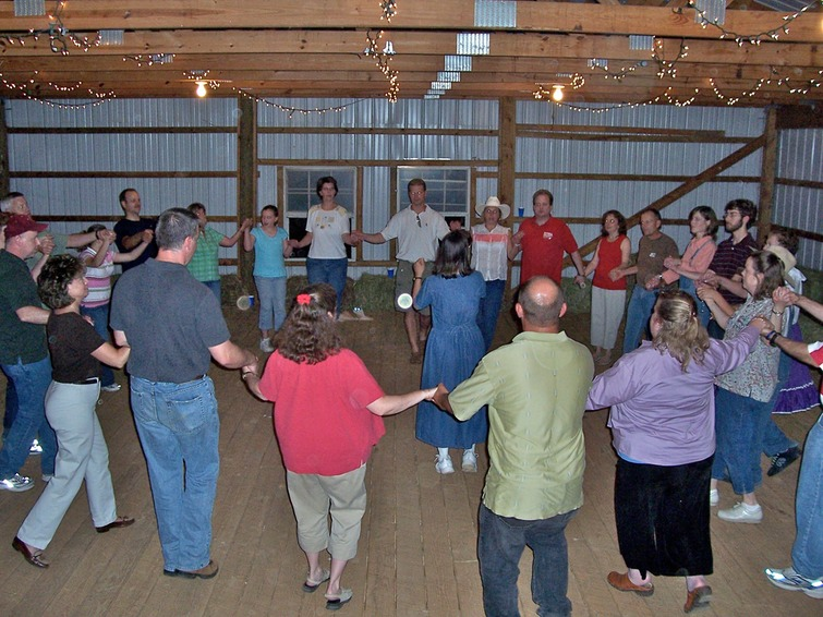 Marcia McKenzie calls the Circle Waltz at a barn dance